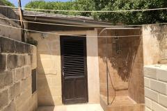 Lavanderia e doccia esterna